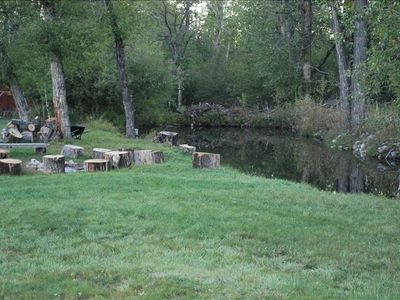 Main outdoor Firepit adjacent to a fishing/swim pond.