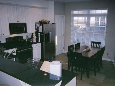 Kitchen Features Stainless Steel Appliances, Large Granite Countertops & Pan