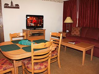 June Lake condo photo - Dining Area and Living Room at The Heidelberg Inn