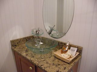 West Yarmouth condo photo - Boutique Bathroom with Vessel Sink and Waterfall Faucet--decadent!
