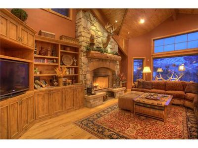 Main Level Family Room,wonderful fireplace, beautiful slope views, great seating
