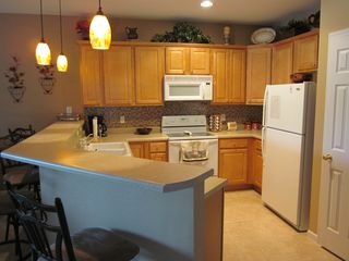 Osage Beach condo photo - Fully equipted kitchen, with coffee, blender, cookware, dishes, etc...