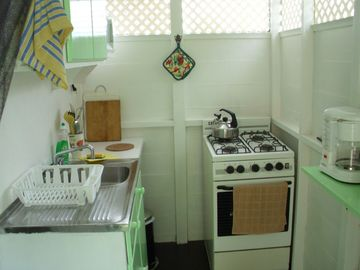 Studio kitchenette stove, microwave, coffee maker toaster, electric kettle