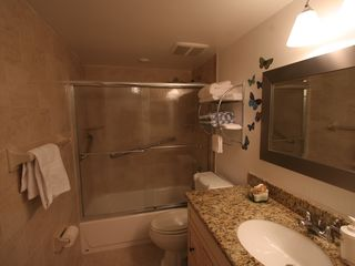Delray Beach apartment photo - Bathroom view with glass sliding doors. Bath and shower.