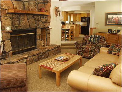 Living Room with HDTV, DVD, Stereo, Wood-Burning Fireplace, & Leather Pull Out Couch.