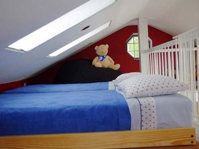 Two, twin trundle beds in loft where older children can spend time and sleep.