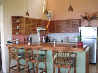 Playa Ocotal house photo - The Spyglass House kitchen and breakfast bar from the dining area.