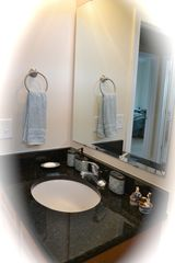 Private Homes house photo - Second floor full bath with granite counter top, bath tub, shower, pantry