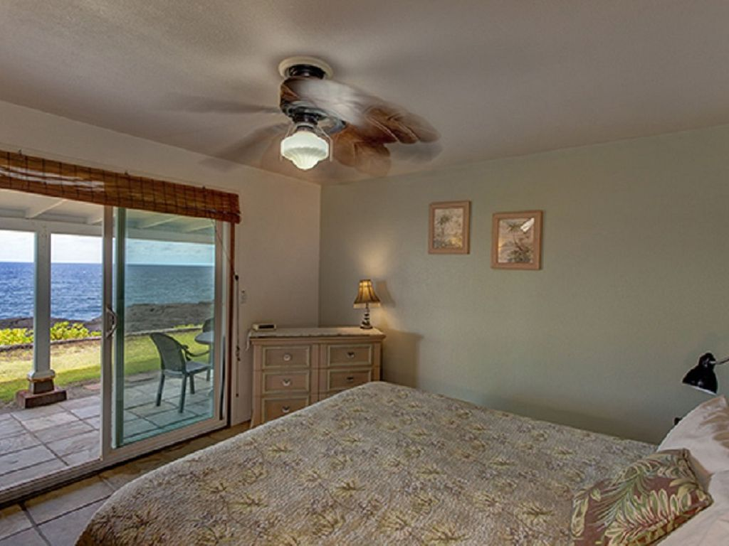 Master bedroom with King bed, sliders to lanai, hot tub and ocean!