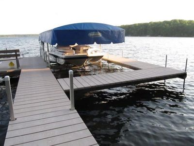 Large private dock, boat lift (no cover), sitting bench, power at shore
