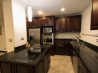 Fully appointed kitchen with stainless appliances and granite countertops.