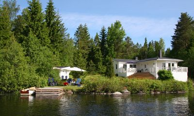 Holiday home,fantastic view of the lake,own boat and a small private footbridge