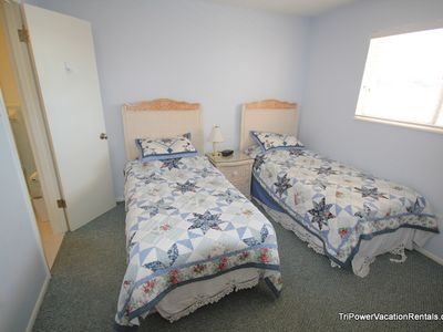 Bedroom #2 with two twin beds includes private bathroom.