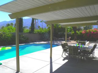 Palm Springs house photo - Shaded Poolside Dining off Kitchen, Another Patio in the Distance at End of Pool