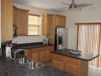 Kitchen w/ stainless steel applicance package and island