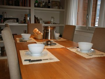The dining table set for a fondue
