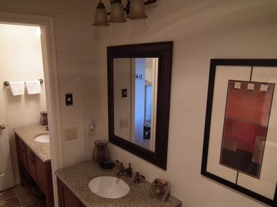 His and Her Dual Vanities with copper fixtures