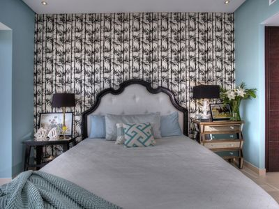 'master' bedroom with a king bed
