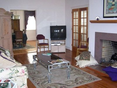 Spacious living room with gas fire place and dinning room