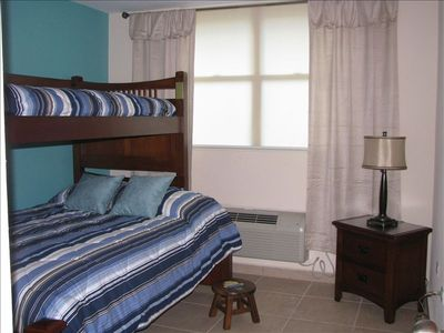 Second bedroom with full and twin beds, with 32