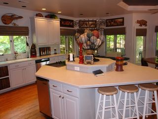 Big Canoe house photo - Oversized kitchen has island/range and seating for 13.