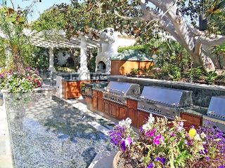 Rancho Santa Fe estate photo - Outdoor Kitchen at Pool - fridge, grills, ovens, ice, keg, micro, fire pit, TV