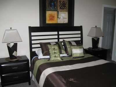Master Bedroom With Queen Size Bed, wall mounted 32' tv/dvd