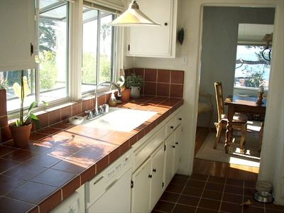 Kitchen sink w/ ocean views in front and through dining area.  Full amenities.