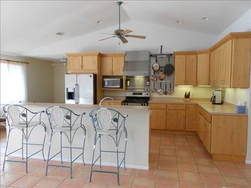 spacious, well equipped kitchen with gas range