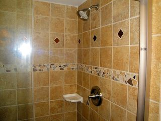 Indian Rocks Beach condo photo - Well appointed and decoratively tiled master bath shower