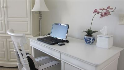 Working desk in the master bedroom complete with wireless internet.