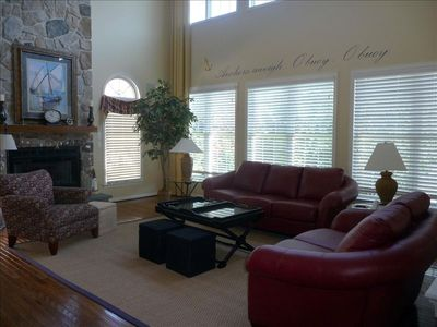 Spacious living room with flat screen television.