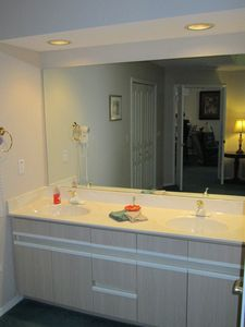 Mornings are a breeze in this brightly lit bathroom with convenient dual sinks