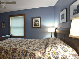 Woodstock house photo - 1st floor bedroom - sleigh bed & family art (my grandfather illustrated books)