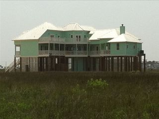 Galveston villa photo - Back view of home from the water showing main deck and third floor deck