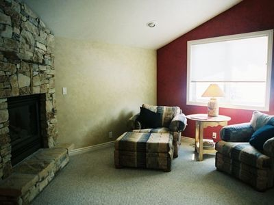 Master bedroom sitting area with flat screen TV and fireplace