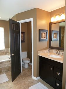 Beautifully appointed master bathroom, this is the mens vanity