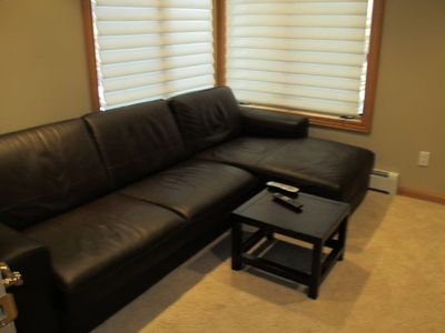 Separate TV den with large flat screen TV and a pull out Sofa Bed.