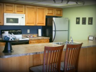 Indian Shores condo photo - Fully equipped Kitchen with new stainless refrigerator with ice maker.