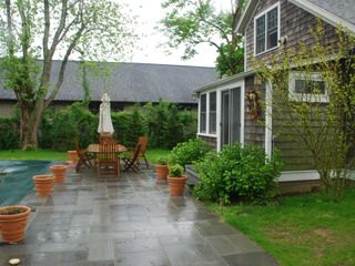 Bridgehampton cottage photo - Slate patio heated pool teak table and chairs