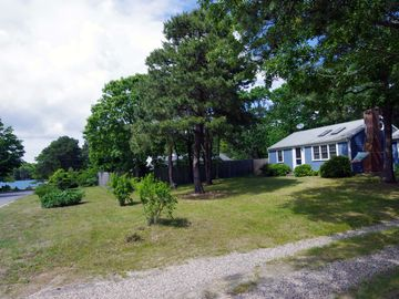 South Yarmouth cottage rental - View of Cottage and Long Pond beach just one door down at the end of the street.