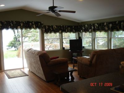 Family room, open windows to the lake