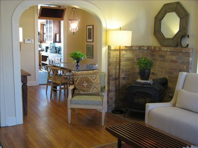Austin house rental - The living room. All wood floors. Organic sofa. Wood-burning stove.