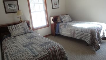 Twin beds upstairs. Looks out toward the road.