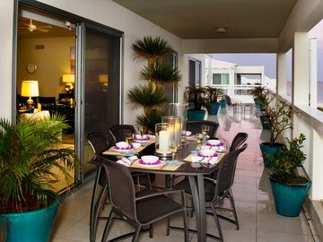 Dine Outside Under Roof and Linger on the Expansive Balcony