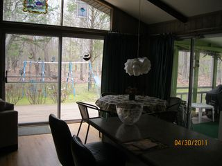 Southold house photo - Dining area looking out to deck with Gas Grill