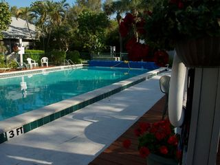 Sanibel Island cottage photo - Pool has tables/chairs/umbrellas/chaise-50 steps from cottage & always quiet!