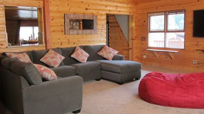 Idyllwild cabin rental - Living area has a large couch with serving area to kitchen.