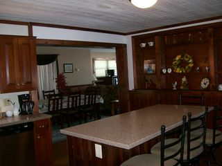 Jefferson farmhouse photo - Spacious kitchen with granite counter tops.