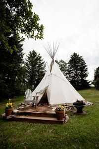 Teepee - has a comfy queen bed inside with rugs and hides on the trex deck.